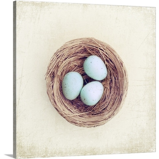 Premium Thick-Wrap Canvas entitled Bird nest with blue baby robins eggs against neutral textured background.
