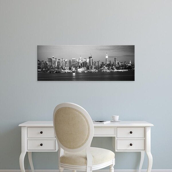 Easy Art Prints Panoramic Image 'Skyscrapers lit up at night in city, Manhattan, New York City, New York' Canvas Art