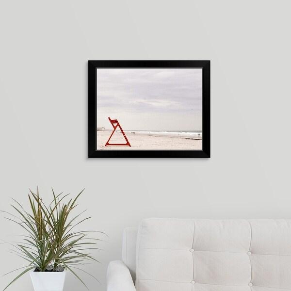 """Red life guard chair on beach"" Black Framed Print"