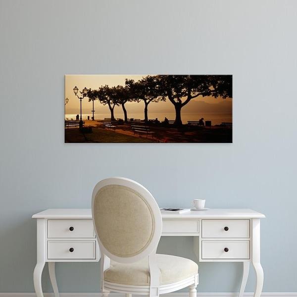 Easy Art Prints Panoramic Images's 'Benches in a park, Torri Del Benaco, Lake Garda, Italy' Premium Canvas Art