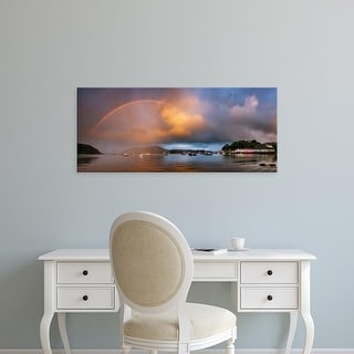 Easy Art Prints Panoramic Images's 'Rainbow over harbor at sunset, Portree, Isle of Skye, Scotland' Premium Canvas Art