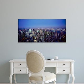 Easy Art Prints Panoramic Images's 'Buildings lit up in a city, New York City, New York, USA' Premium Canvas Art