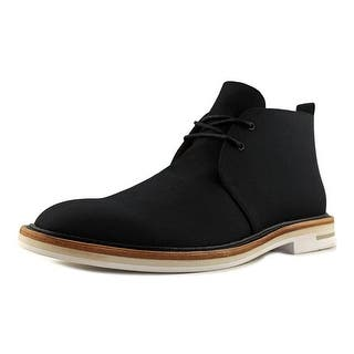 Calvin Klein Jonas Men Wingtip Toe Canvas Chukka Boot|https://ak1.ostkcdn.com/images/products/is/images/direct/9e163b38c85ce9034ebb4994112183c38ec8f492/Calvin-Klein-Jonas-Men-Wingtip-Toe-Canvas-Black-Chukka-Boot.jpg?impolicy=medium