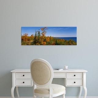 Easy Art Prints Panoramic Images's 'Trees along a lake, Lake Superior, Minnesota, USA' Premium Canvas Art