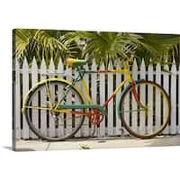 Premium Thick-Wrap Canvas entitled Colorful bike with picket fence - Multi-color