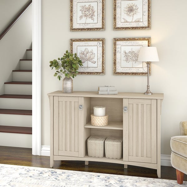 "The Gray Barn Lowbridge Antique White Storage Cabinet with Doors - 46.22""L x 12.76""W x 29.96""H. Opens flyout."