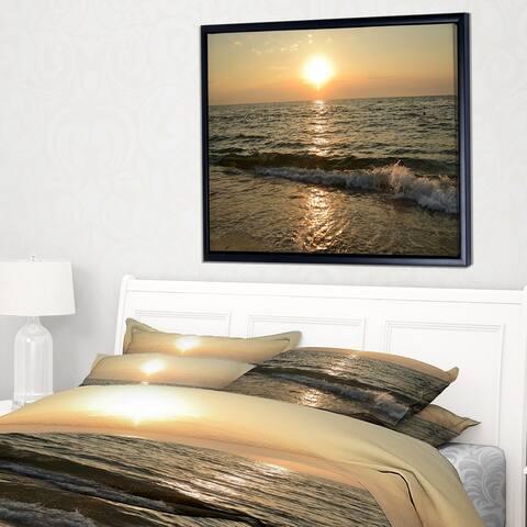 Designart 'Black Seascape in Morning Sunlight' Beach Photo Framed Canvas Print