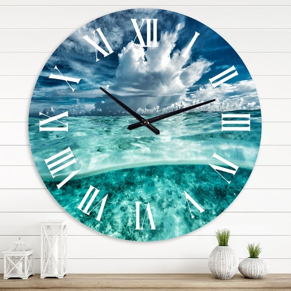 Designart 'Amazing Underwater Seascape and Clouds' Nautical & Coastal wall clock. Opens flyout.