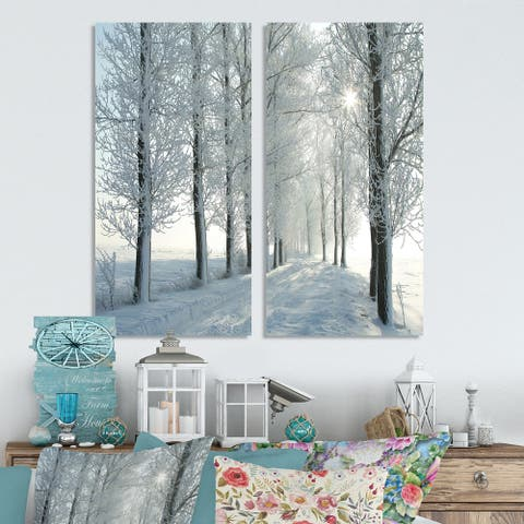 Designart 'Winter Trees Backlit by Morning Sun' Large Forest Canvas Wall Art Print 2 Piece Set
