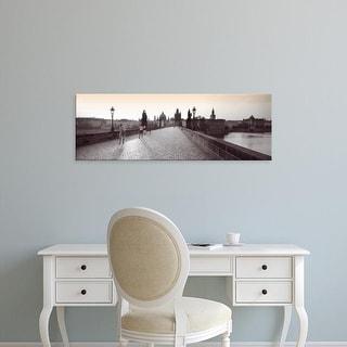 Easy Art Prints Panoramic Images's 'Tourist Walking On A Bridge, Charles Bridge, Prague, Czech Republic' Canvas Art