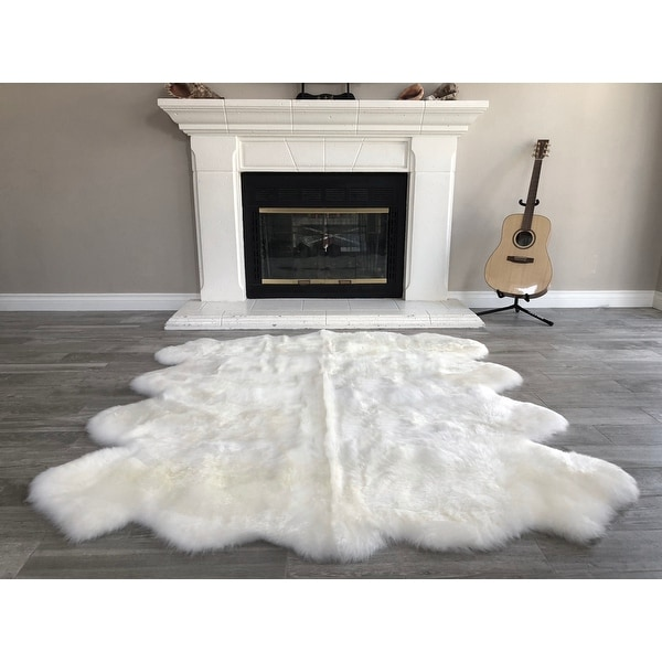 "Dynasty Natural 8-Pelt Luxury Long Wool Sheepskin Shag Rug - 5'5 x 6'8"". Opens flyout."