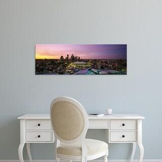 Easy Art Prints Panoramic Images's 'Skyscrapers lit up at sunset, Minneapolis, Minnesota, USA' Premium Canvas Art