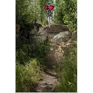 """Downhill biker riding off cliff"" Poster Print"