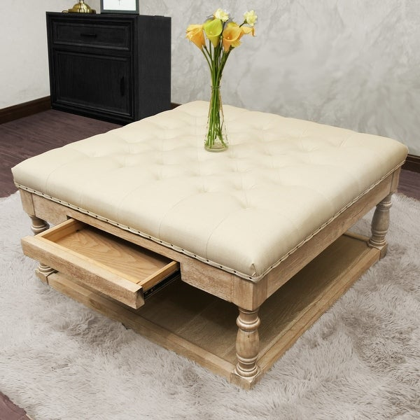 Suleiman Tufted Padded Cocktail Ottoman with Shelf and Drawer. Opens flyout.