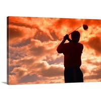Premium Thick-Wrap Canvas entitled golf player in the sunset - Multi-color