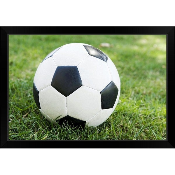 """Soccer ball on grass"" Black Framed Print"