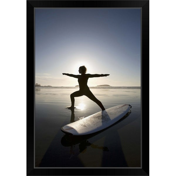 """silhouette of female surfer doing warrior yoga pose"" Black Framed Print"