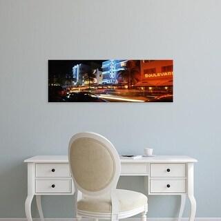 Easy Art Prints Panoramic Image 'Buildings at the roadside, Ocean Drive, South Beach, Miami Beach, Florida' Canvas Art