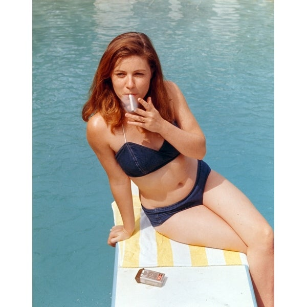 51cb895a76 Shop Patty Duke sitting in Purple Bikini Photo Print - Free Shipping On  Orders Over  45 - Overstock - 25386622