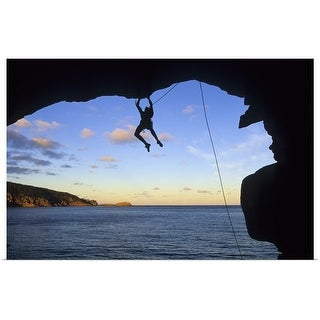 """""""Silhouette of man rock climbing in cave over water"""" Poster Print"""