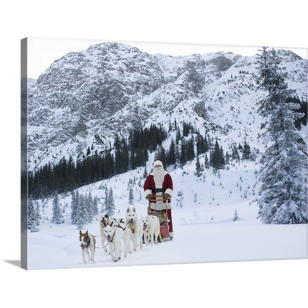 """A team of Husky dogs pulling Santa Claus and his sleigh"" Canvas Wall Art"