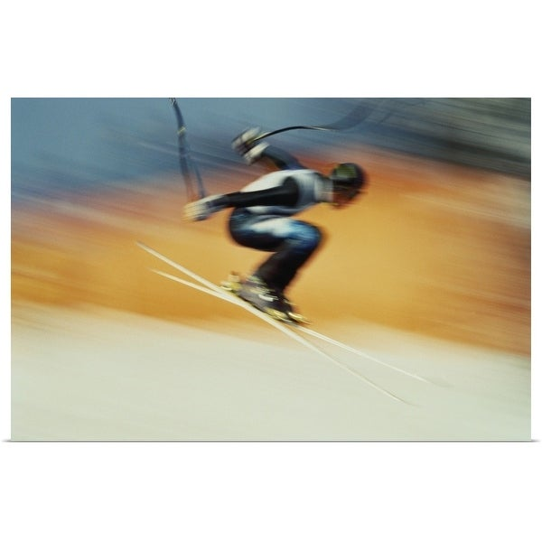 """Ski racer in mid-air jump (blurred motion)"" Poster Print"