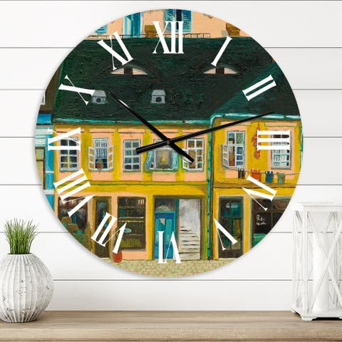 Designart 'Yellow Facade of Houses In Street In Paris' French Country wall clock
