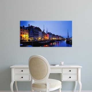 Easy Art Prints Panoramic Images's 'Buildings lit up at night, Nyhavn, Copenhagen, Denmark' Premium Canvas Art