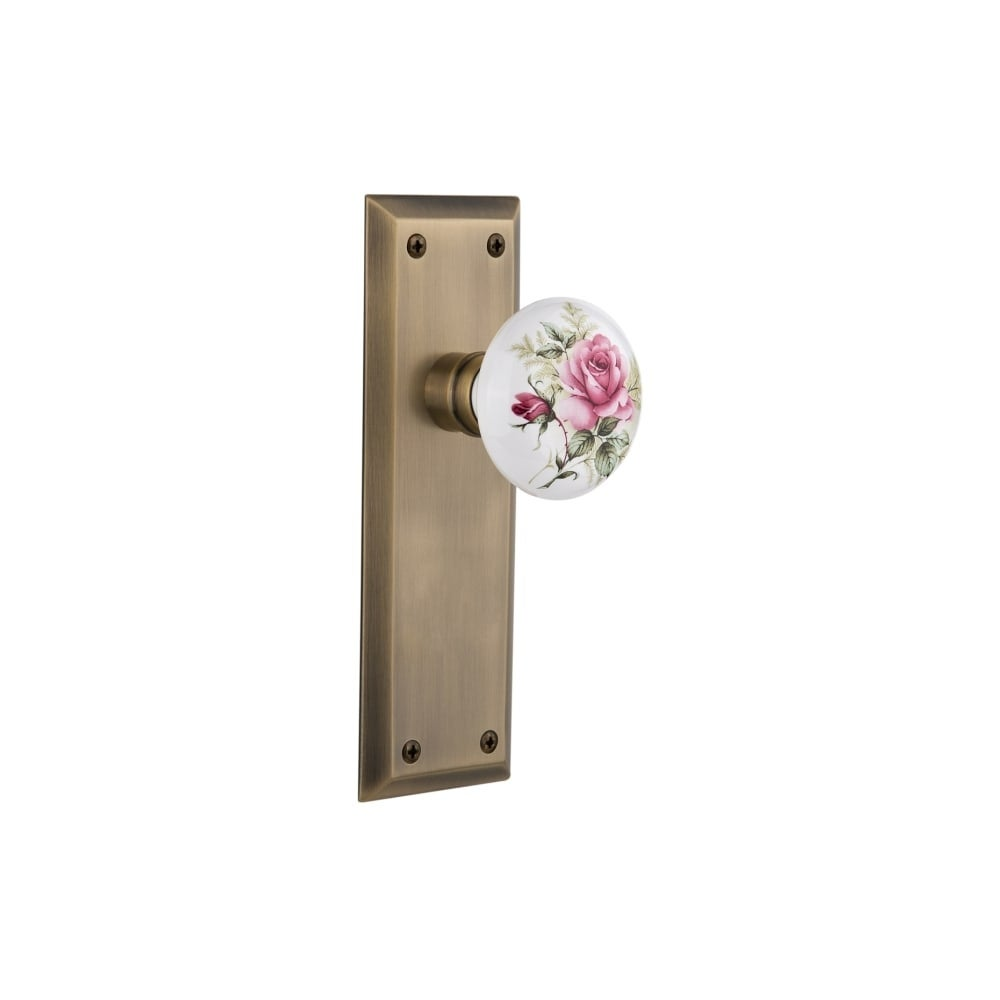 Nostalgic Warehouse NYKROS_PSG_238_NK  Rose Porcelain Solid Brass Passage Knob Set with New York Rose and 2-3/8 Backset (Antique Brass)