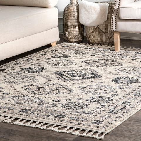 The Curated Nomad Ashbury Traditional Vintage Geometric Border Tassel Area Rug