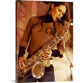 """""""Woman Stands on a Smoky Stage Playing a Saxophone With Passion"""" Canvas Wall Art"""