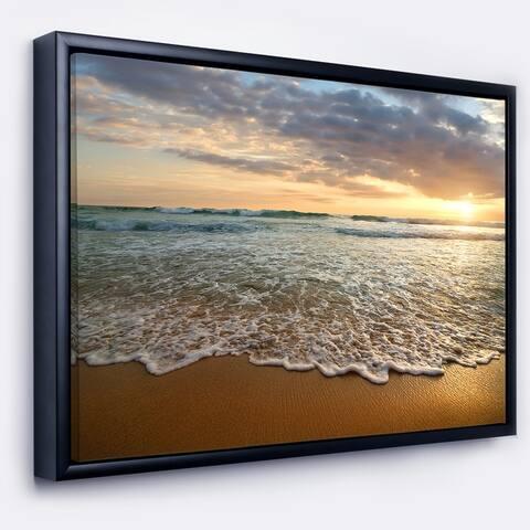 Designart 'Bright Cloudy Sunset in Calm Ocean' Seashore Framed Canvas Art Print
