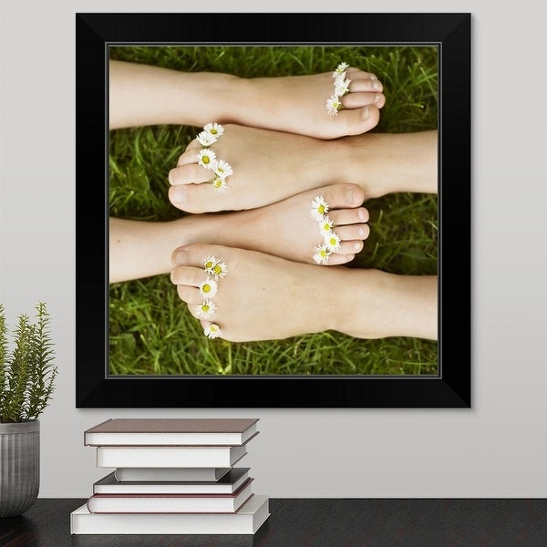 """""""Close up of daisies on children's toes"""" Black Framed Print"""