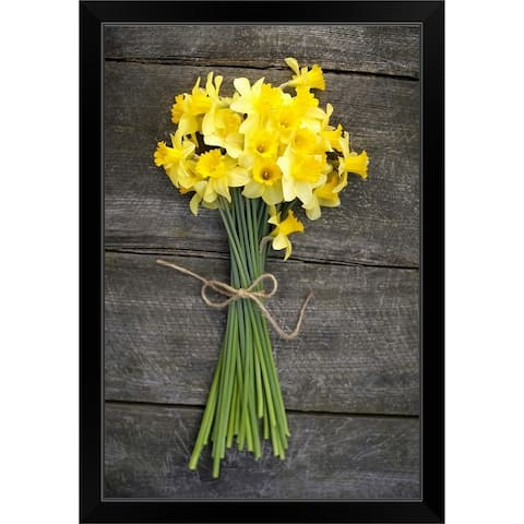 """""""Bunch of daffodils on a wooden table"""" Black Framed Print"""