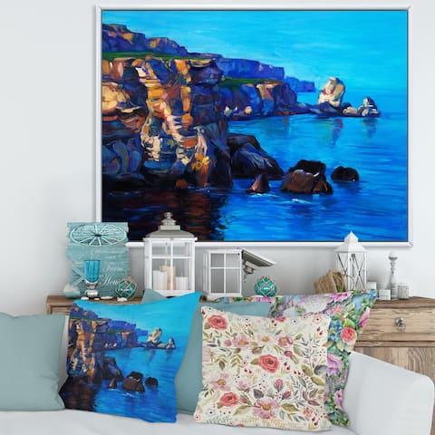 Designart 'Cliffs By The Ocean In The Evening Glow' Nautical & Coastal Framed Canvas Wall Art Print