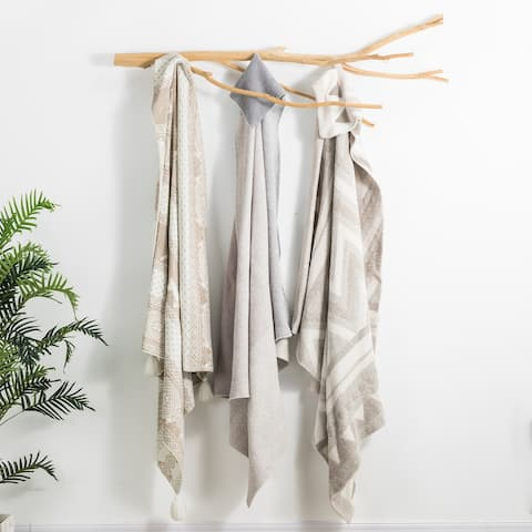 The Curated Nomad Division Knitted Feather Yarn Throw Blanket