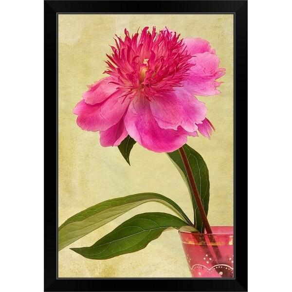 """Pink Peony flower in an antique, pink, glass vase."" Black Framed Print"