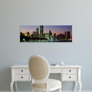 Easy Art Prints Panoramic Image 'Buildings lit up at dusk, Lake Michigan, Chicago, Cook County, Illinois' Canvas Art