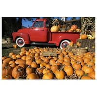 Poster Print entitled Pumpkin farm with a red pickup truck in Peconic, New York - Multi-color