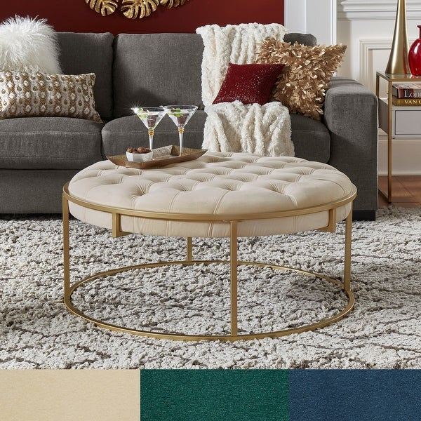 Perdita Gold Finish Velvet Round Tufted Cocktail Ottoman by iNSPIRE Q Bold. Opens flyout.