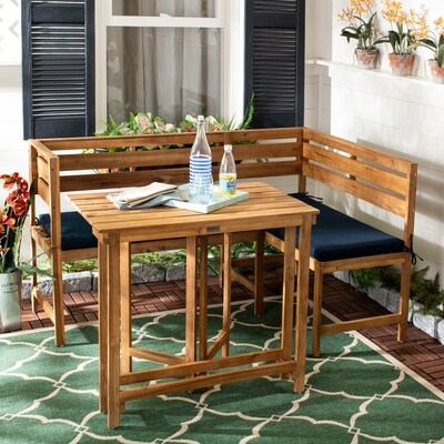Outdoor Wooden dining set with blue seat cushions on a green area rug available for up to 25% off online when you shop at Overstock.com