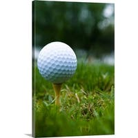 Premium Thick-Wrap Canvas entitled Golf ball on tee - Multi-color