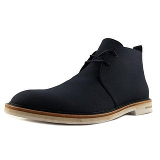 Calvin Klein Jonas Men Wingtip Toe Canvas Chukka Boot|https://ak1.ostkcdn.com/images/products/is/images/direct/be227cb59bbd05fc9aa7ae017aaa5a1e89138568/Calvin-Klein-Jonas-Men-Wingtip-Toe-Canvas-Blue-Chukka-Boot.jpg?_ostk_perf_=percv&impolicy=medium