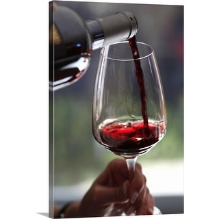 """""""Pouring a sampling of red wine at a wine tasting"""" Canvas Wall Art"""
