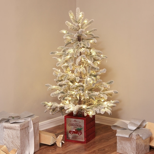 Pre-Lit Clear LED 4ft Porch Artificial Flocked Tree with Red Wood Base. Opens flyout.