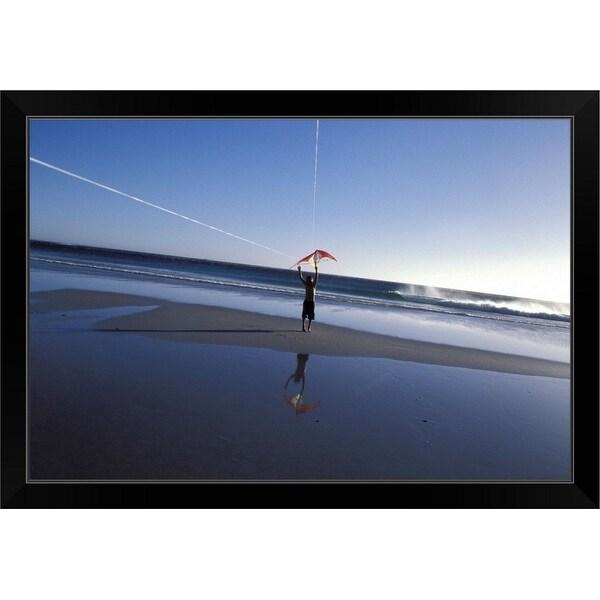 """Boy flying kite at beach"" Black Framed Print"
