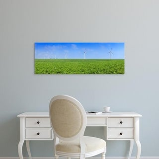 Easy Art Prints Panoramic Images's 'Field of potatoes in bloom with wind turbines, Thil