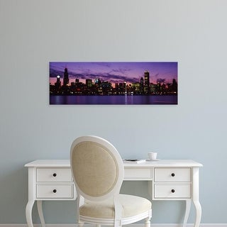 Easy Art Prints Panoramic Image 'Buildings at the waterfront blurred, Lake Michigan, Chicago, Illinois' Canvas Art