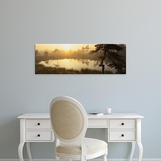 Easy Art Prints Panoramic Images's 'Reflection of trees in a lake, Vastmanland, Sweden' Premium Canvas Art