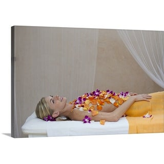 Premium Thick-Wrap Canvas entitled Woman getting a flower treatment at a spa